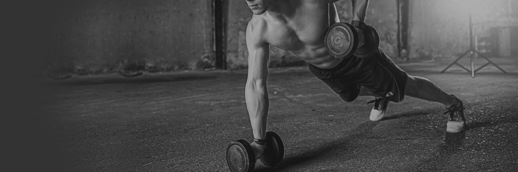 strong-man-lifting-barbells-fitness